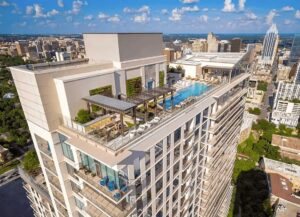 Rooftop pool with view of Downtown Austin at The Bowie apartment building