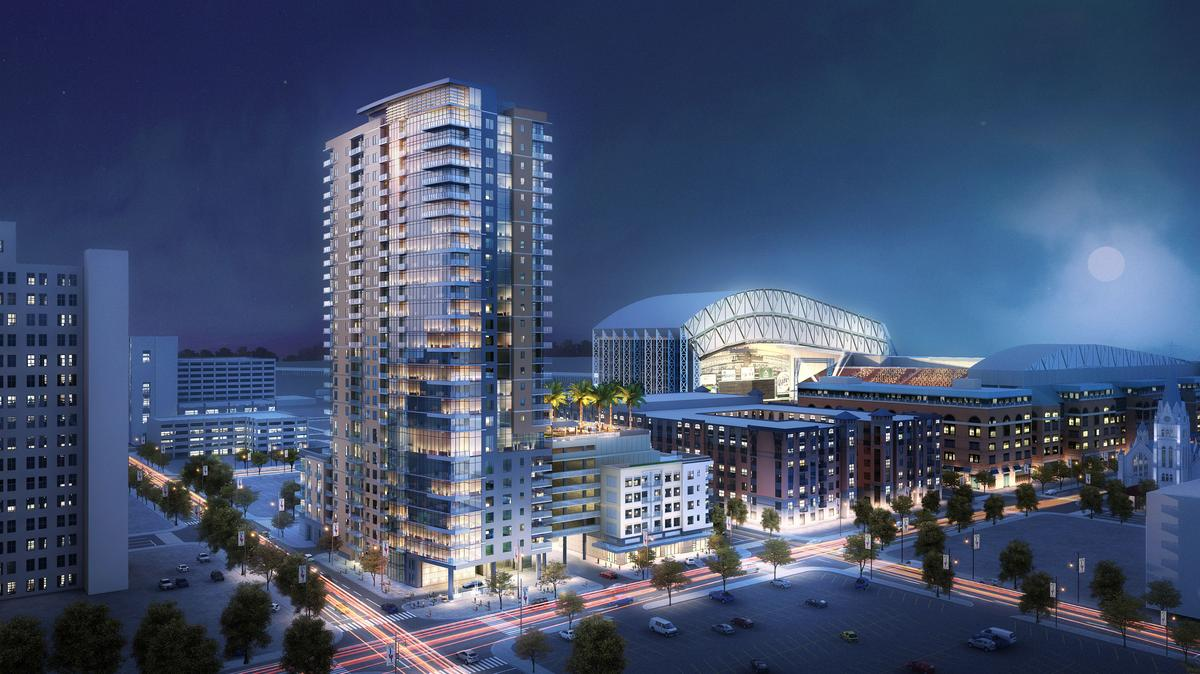 Exterior view of Catalyst high-rise apartments in Downtown Houston with view of Minute Maid Stadium